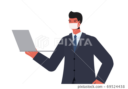 businessman using laptop wearing mask to prevent coronavirus pandemic labor day celebration 69524438