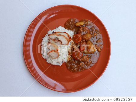 Top view, Yellow Curry Chicken with cooked rice in the round orange color of dish 69525557