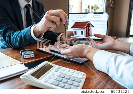 Real estate agent are presenting home loan and 69535122