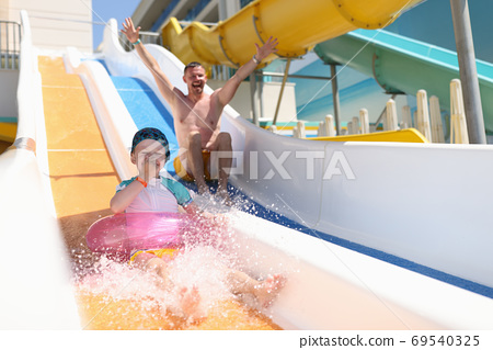 Family spend time at aquapark. 69540325