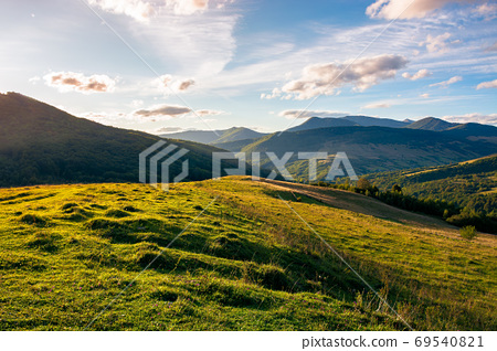rural landscape in mountains at sunset. grassy pasture on the hi 69540821