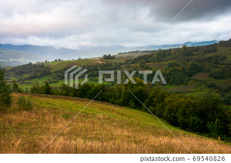 rural landscape in mountain on a cloudy morning. dramatic hazy s 69540826