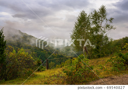 rural landscape in mountain on a cloudy morning. dramatic hazy s 69540827