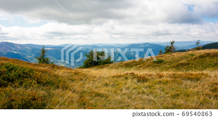 mountain landscape in autumn. dry colorful grass on the hills. r 69540863