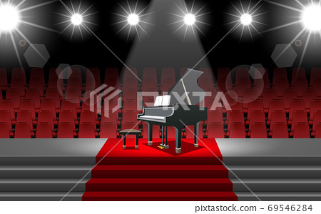 piano and spotlight on the stage in the hall 69546284