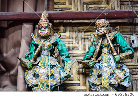 Traditional handicraft puppets are sold in a market at Mandalay, Myanmar. 69556306