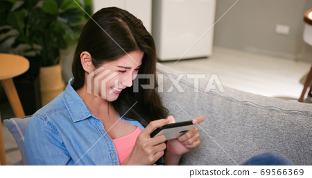 asian woman play mobile games 69566369