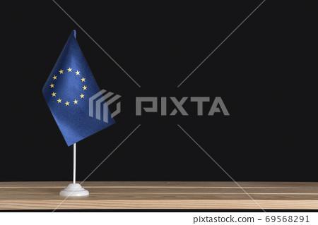 Flag pole. National table flag of EU on black background. 69568291