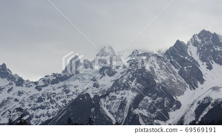 the beautiful and dangerous mountain in foggy weather, Mount Yulong or Jade Dragon Snow Mountain in Lijiang country, Yunnan province 69569191