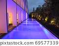 Hotel night pool lit up in fantastic shades 69577339