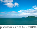 Calm and beautiful blue sea with green islands 69579896