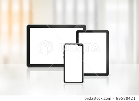 Mobile phone and digital tablet pc on office desk 69588421