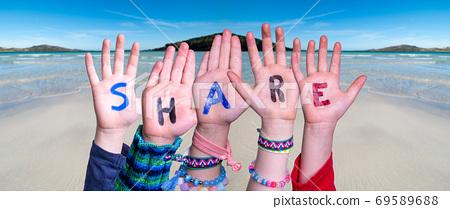 Children Hands Building Word Share, Ocean Background 69589688