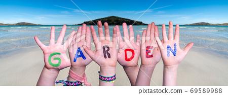 Children Hands Building Word Garden, Ocean Background 69589988