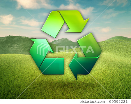 Recycling symbol in a green meadow 69592221