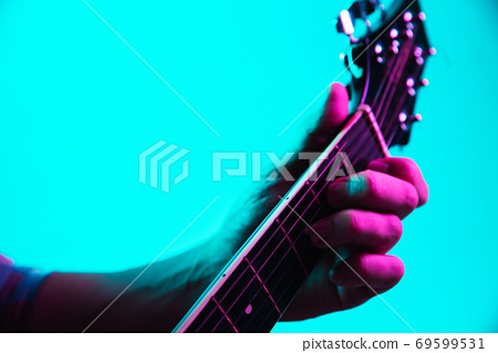 Close up of guitarist hand playing guitar, copyspace, macro shot 69599531