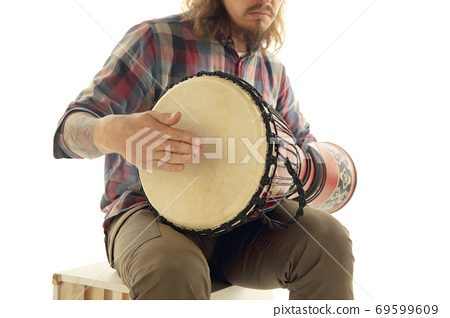 Man plays ethnic drum darbuka percussion, close up musician isolated on white studio background 69599609