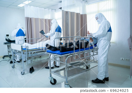 Doctor in hazmat PPE protective clothing wear medical rubber gloves holding an X-ray film. 69624025