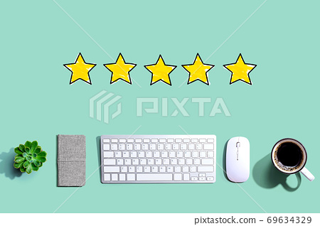 Five star rating with a computer keyboard 69634329