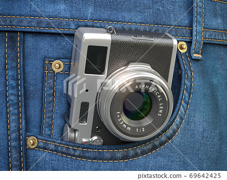 Vintage compact photo camera in jeans pocket. Blogging, travel and tourism concept. 69642425
