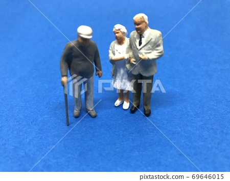 Old man's model / doll, image of aging society (blue background) 69646015