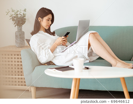 Young asian woman using smartphone at home 69646612