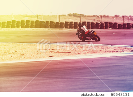 motorcycle racer rides on a sports track 69648151