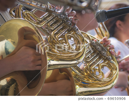 Selective focus of french horn musician.  69650906