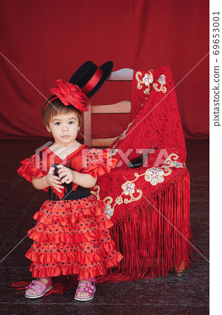 Baby girl in flamenco dress 69653001