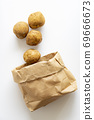 Potatoes popping out of a craft bag 69666673