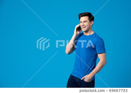 Caucasian man having a conversation on mobile phone 69667783