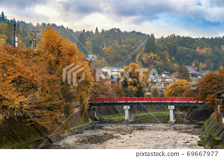 Takayama Japan, autumn landscape foliage at red Nakabashi bridge and Miyakawa river 69667977