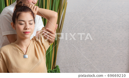 Thai Masseuse doing massage for woman in spa salon 69669210