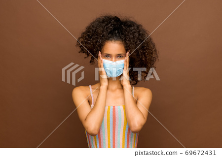 Dominican girl wearing a protective face mask 69672431