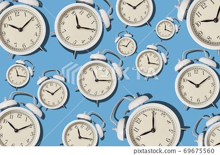 Vintage alarm clock pattern on a blue background, minimal style 69675560