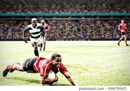 Digital composite image of rugby player jumping with the ball to score touchdown in sports stadium 69676985