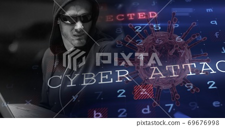 Hacker during coronavirus covid19 pandemic using laptop 69676998