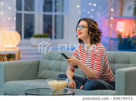 woman watching TV 69679453