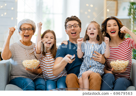 Happy family spending time together. 69679563