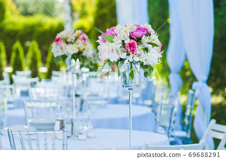 A bouquet of flowers decorates the festive table 69688291