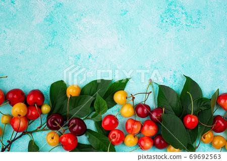 Fresh ripe red and yellow cherry 69692563