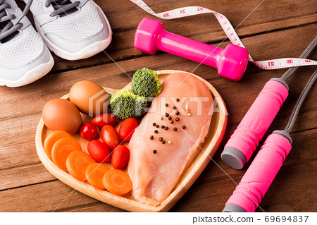 Raw chicken breasts fillets in heart plate wood and sport or athlete's equipment 69694837