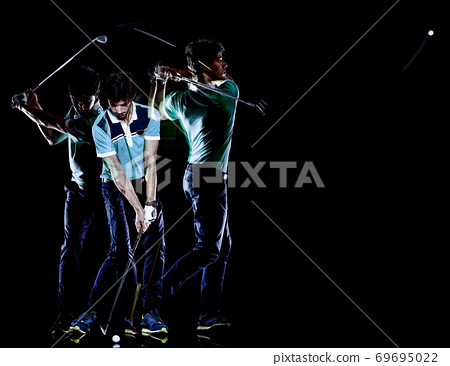 Golfer man golfing golf swing isolated black background multiple exposure 69695022