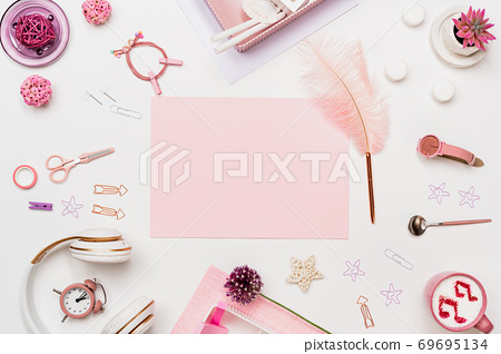 Pink blank paper on fashion feminine desk top view 69695134