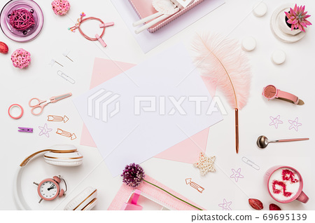 Flat lay desk composition in pastel pink tone 69695139