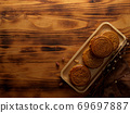 Top view of moon cakes on wooden tray and copy space on rustic table 69697887