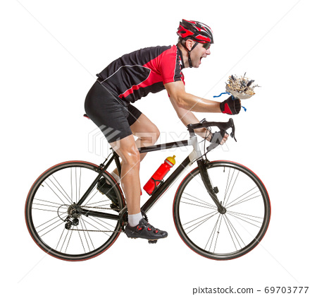 winning cyclist riding a bike with flower in hand 69703777