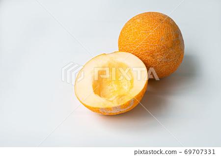 Raw organic half melon on a wooden board. Summer fruit concept 69707331