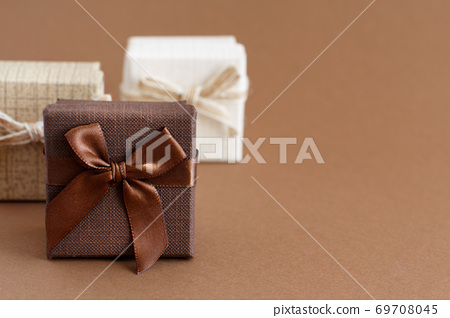 Brown tones gift boxes on a brown background 69708045