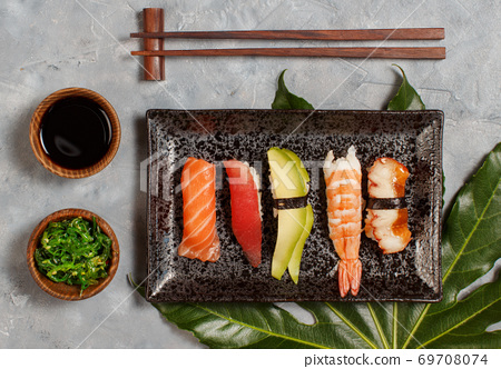 Sushi Set nigiri and sushi rolls on rectangular plate 69708074